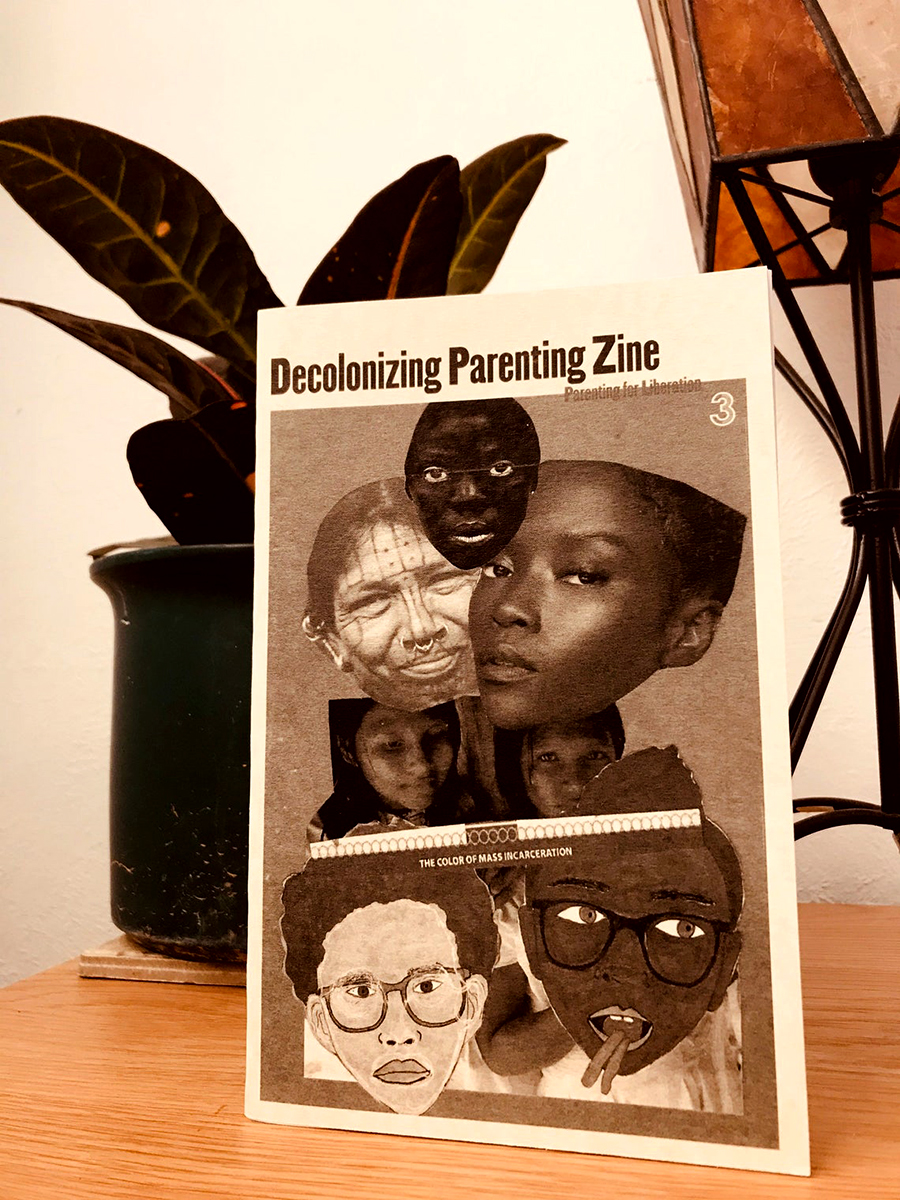 photo of zine cover: Black family collage. Zine standing by a planter.